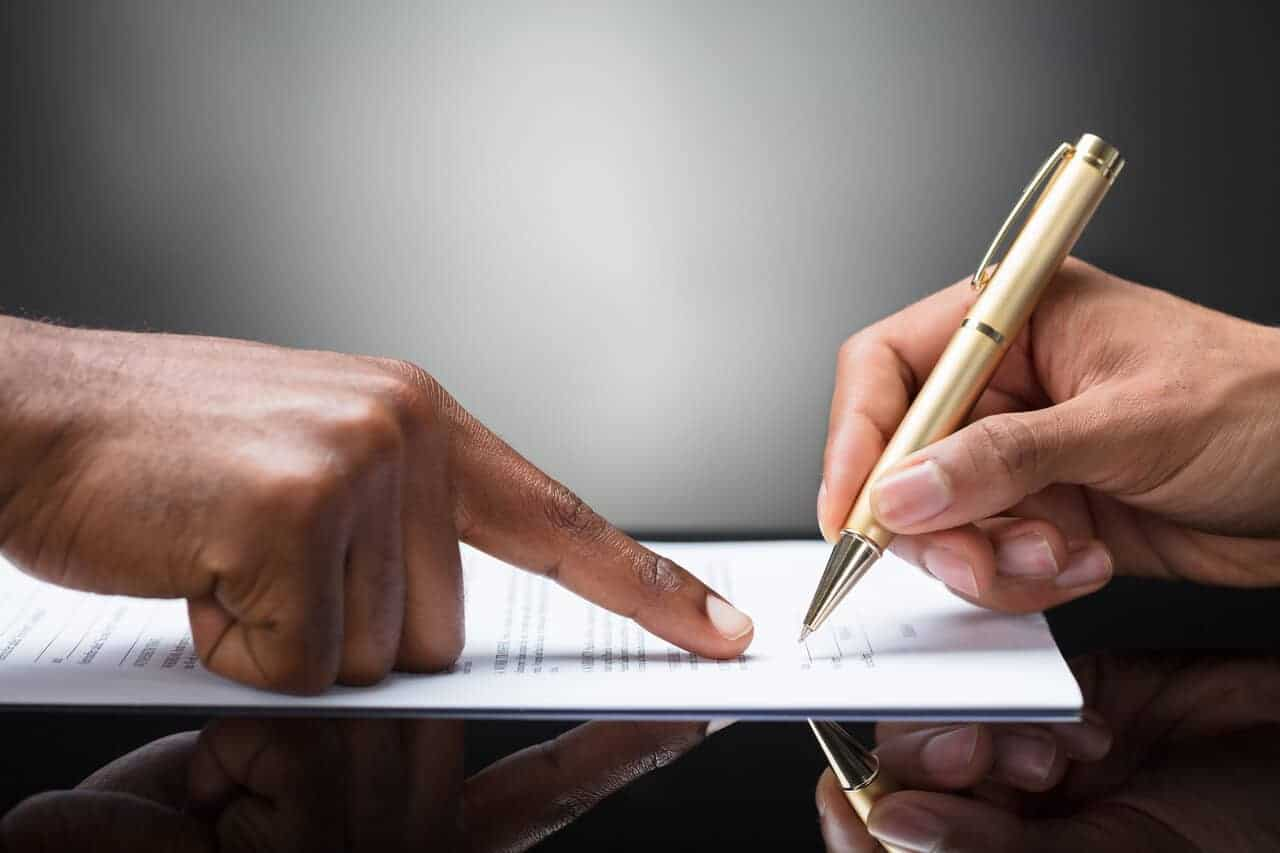 Man Signing Loan With a Legal Money Lender